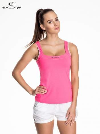 Różowy damski top sportowy z lamówką
