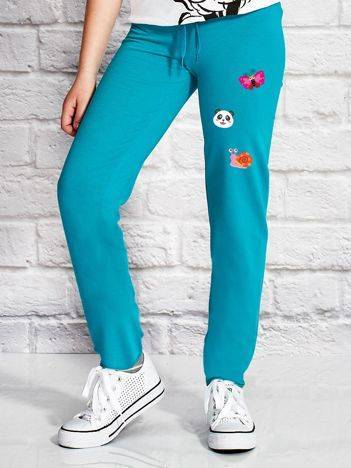 Spodnie dresowe dla dziewczynki w zwierzęce motywy zielone