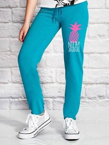 Spodnie dresowe dla dziewczynki z ananasem zielone