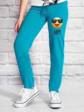 Spodnie dresowe dla dziewczynki z motywem emoji zielone