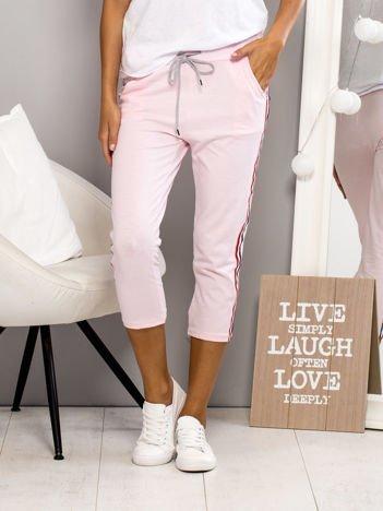 Spodnie dresowe z lampasami różowe
