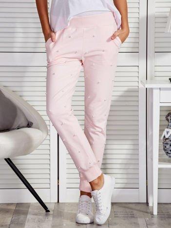 Spodnie dresowe z perełkami jasnoróżowe