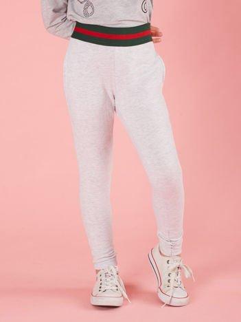Szare dziewczęce spodnie dresowe z kieszeniami