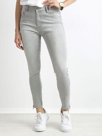 Szare jeansy z suwakami