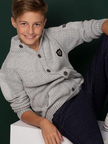 Szary sweter dla chłopca z kieszeniami
