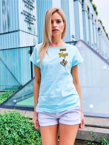 T-shirt damski turkusowy z naszywkami cekinowymi z motywem marynarskim