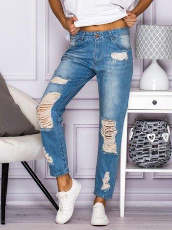 Wytarte spodnie jeansowe boyfriend z dziurami niebieskie