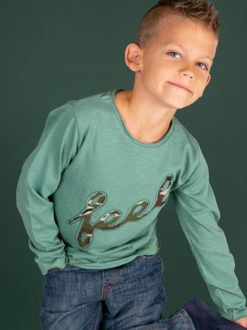 Zielona bawełniana bluzka dla dziewczynki z moro aplikacją