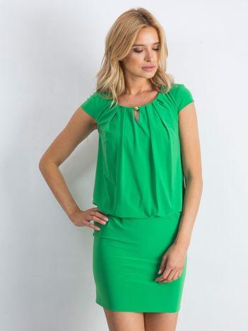Zielona sukienka Transformative