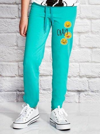 Zielone spodnie dresowe dla dziewczynki z napisem CRAZY
