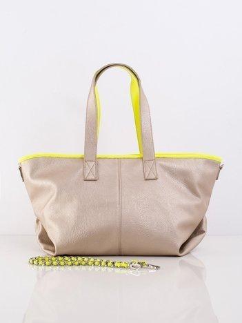 Złota torba z ozdobnym paskiem