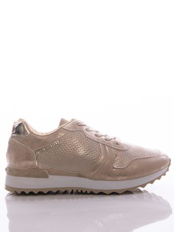 Złote buty sportowe z tłoczoną wstawką i metalicznym połyskiem, na sprężystej podeszwie