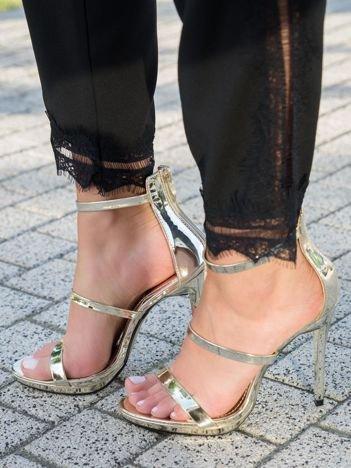 Złote sandały na szpilkach z wysoką cholewką z tyłu i suwakiem na pięcie
