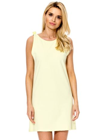Żółta sukienka z dekoltem z tyłu
