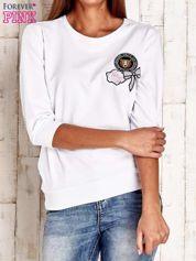 Biała bluza z naszywkami i ściągaczami