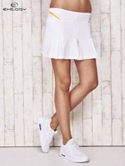 Białe spodenki spódniczka tenisowa z pomarańczowymi wstawkami
