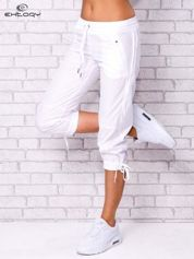 Białe spodnie sportowe capri z siateczką