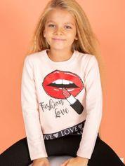 Brzoskwiniowa asymetryczna bluzka dziewczęca nadrukiem ust