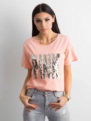 Brzoskwiniowa koszulka z cekinowym napisem