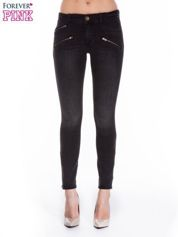 Ciemnoszare spodnie jeansowe typu skinny z suwakami na górze i przy nogawkach