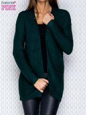 Ciemnozielony dziergany sweter