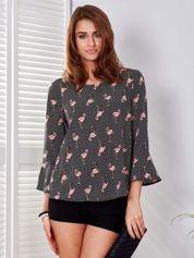 Czarna bluzka w groszki i flamingi