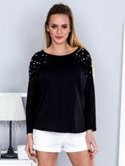 Czarna bluzka z perełkami o koronkowymi wstawkami
