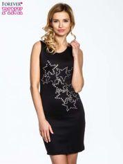 Czarna dopasowana sukienka z wzorem gwiazd