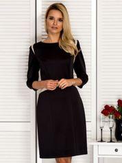 Czarna sukienka z kontrastowymi skórzanymi wstawkami