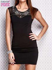 Czarna sukienka z siateczkowym dekoltem i aplikacją
