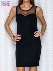 Czarna sukienka z tiulowym dekoltem