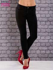 Czarne jeansowe spodnie skinny jeans z kieszeniami