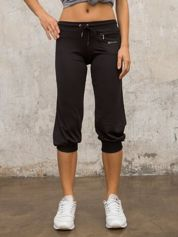 Czarne spodnie capri z dżetami i kieszonką