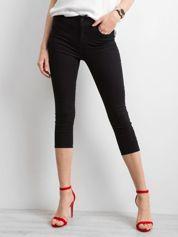 Czarne spodnie jeansowe skinny z kokardkami
