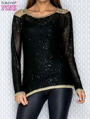 Czarny sweter ze złotymi wstawkami