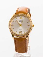 Damski zegarek. Klasyczny, ale nie ma nudy - za to są cyrkonie.