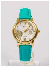 Damski zegarek z ozdobnym wzorem na tarczy.