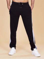 Dresowe spodnie męskie z lampasami czarne