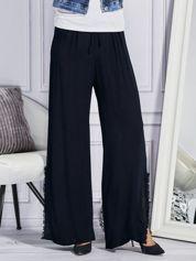 Granatowe spodnie z rozcięciami