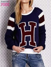 Granatowy sweter z literą H