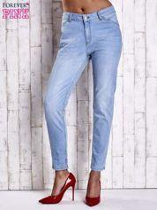 Jasnoniebieskie jeansowe spodnie z guzikami na nogawkach