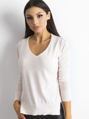 Jasnoróżowy luźny damski sweter