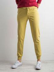 Miodowe spodnie dresowe z troczkami