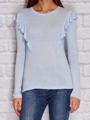 Niebieska bluzka z falbanami