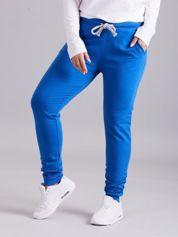 Niebieskie spodnie dresowe PLUS SIZE