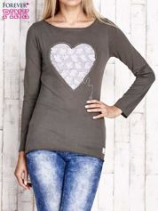 Oliwkowa bluzka z materiałową wstawką