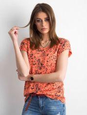 Pomarańczowa koszulka w kwiaty
