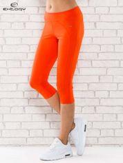 Pomarańczowe legginsy 3/4 sportowe termalne z lampasami