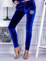 Spodnie dresowe welurowe z błyszczącymi kamyczkami niebieskie