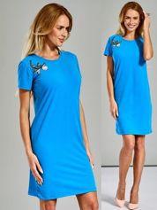 Sukienka dresowa z kwiatową naszywką niebieska
